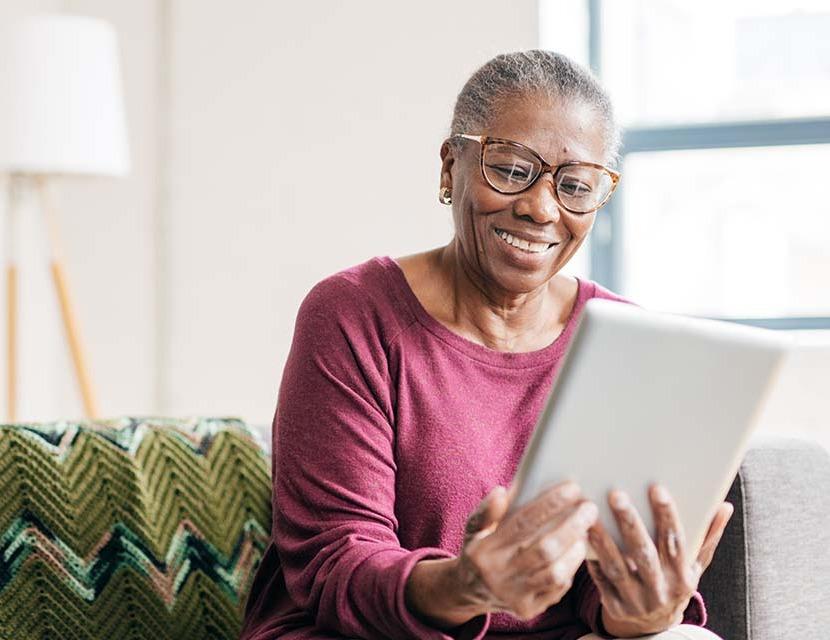 Senior women at home using tablet